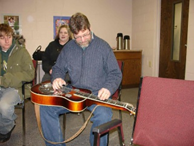A banjo workshop held by the Hiawatha Music Co-op.