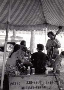 Musicians jam together in Tourist Park at an early festival.