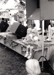 Wade and Callie Youngman sit on Second Stage, as their father, Frank Youngman performs.