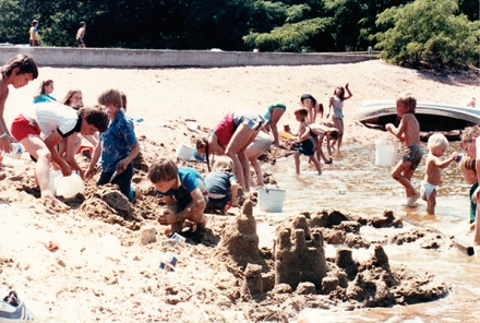 Children play at the beach at Tourist park.