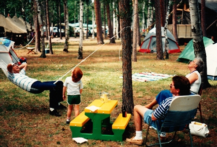 Steve Sleight, John Warsler, and Joann Sleight relax during the 1990 festival at Tourist Park.